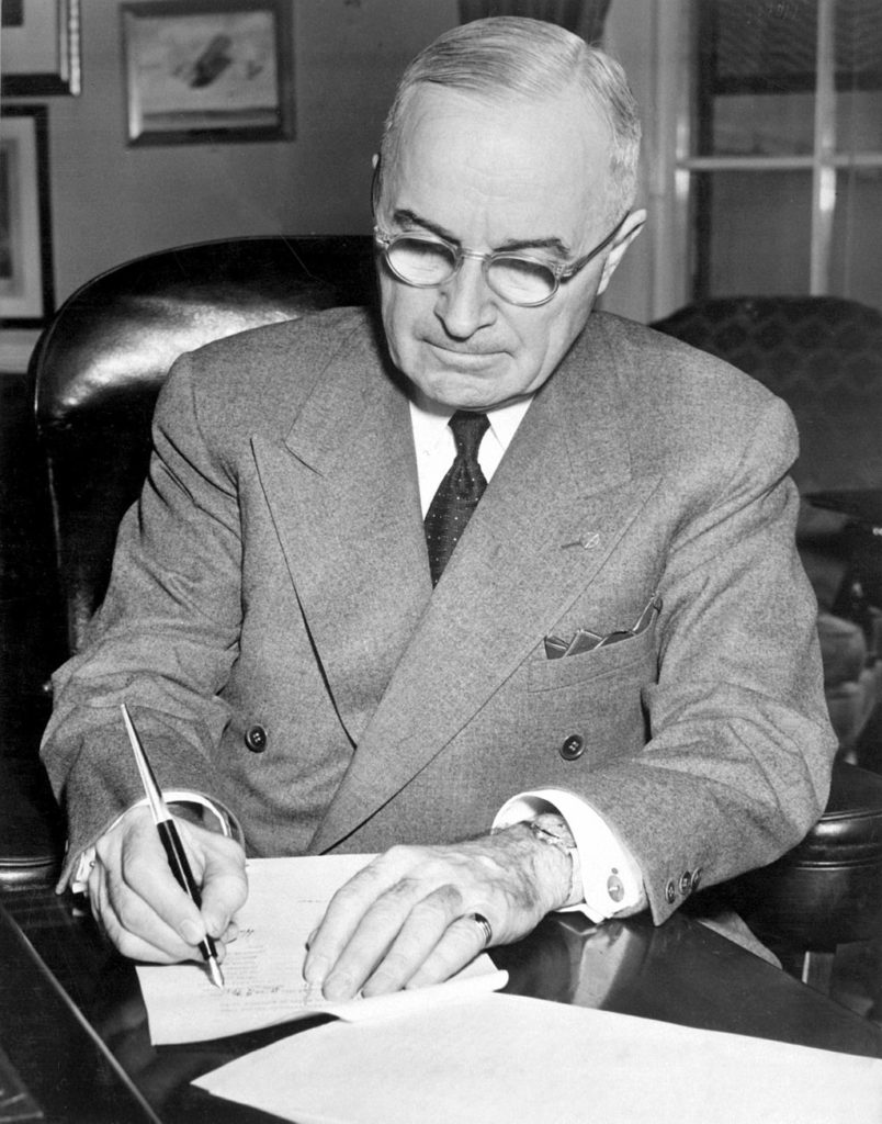 Harry S. Truman signs